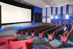 Rows of seats and screen in Neva cinema Stock Photos