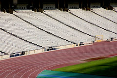 Rows of seats in stadium and track and field lane Royalty Free Stock Image