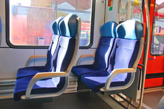 Rows of seats in a train car. Rows of seats in a passenger train car Royalty Free Stock Photography
