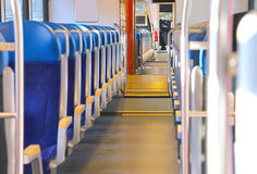 Rows of seats in a train car. Rows of seats in a passenger train car Royalty Free Stock Images
