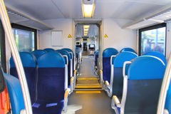 Rows of seats in a train car. Rows of seats in a passenger train car Stock Photos
