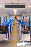 Rows of seats in a train car. Rows of seats in a passenger train car Stock Images