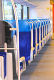 Rows of seats in a train car. Rows of seats in a passenger train car Royalty Free Stock Photo