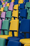 Rows of Seats Vertical. Rows of empty brightly colored seats in a cinema, auditorium or lecture hall royalty free stock images