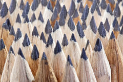 Rows of sharp ground graphite wooden texture pencil nibs Stock Image