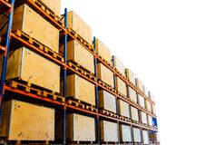 Rows of shelves with boxes in factory warehouse Royalty Free Stock Images