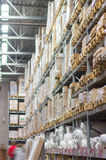 Rows of shelves with boxes in modern warehouse Royalty Free Stock Image