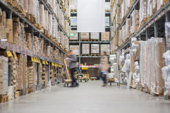 Rows of shelves with boxes in modern warehouse Royalty Free Stock Images