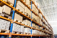 Rows of shelves with boxes Royalty Free Stock Photos