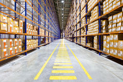 Rows of shelves with boxes. In modern warehouse Royalty Free Stock Photo