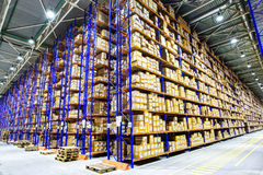 Rows of shelves with boxes. In modern warehouse Stock Images