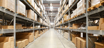Rows Of Shelves With Boxes. In Warehouse Royalty Free Stock Photography