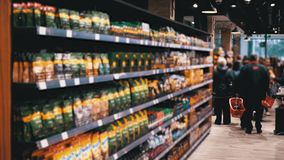 Rows and Shelves with Various Goods in the Supermarket. Buyers Choose the Product. stock video