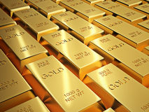 Rows of shiny gold bullion Stock Photo