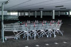 Rows of shopping carts in abandoned car park Royalty Free Stock Images