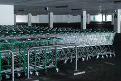 Rows of shopping carts in abandoned car park Stock Photography