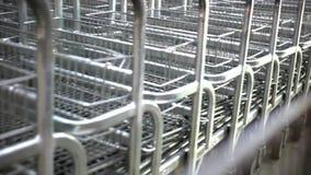 Rows of shopping carts on car park near entrance stock video