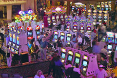 Rows of slot machines and gamblers at Rio Casino in Las Vegas, NV Royalty Free Stock Photos