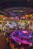 Rows of slot machines and gamblers at Rio Casino in Las Vegas, NV Royalty Free Stock Image
