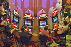 Rows of slot machines and gamblers at Rio Casino in Las Vegas, NV Stock Photography