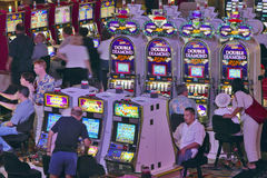 Rows of slot machines and gamblers at Rio Casino in Las Vegas, NV Royalty Free Stock Photo