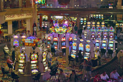 Rows of slot machines and gamblers at Rio Casino in Las Vegas, NV Stock Image