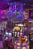 Rows of slot machines and gamblers at Rio Casino in Las Vegas, NV Royalty Free Stock Photography