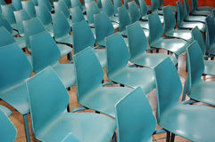 Rows of small blue chairs. Arrangement of rows of small blue chairs Royalty Free Stock Photos