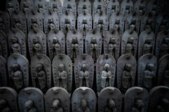 Rows of small buddhist statues Royalty Free Stock Image