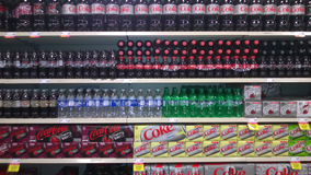 Rows of soda beverage selling at supermarket Royalty Free Stock Images