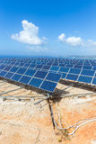 Rows of solar panels near sea with blue sky Royalty Free Stock Photography