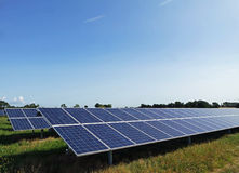 Rows of solar PV panels. Two rows of PV type solar panels in a solar farm in Kent, England. working on a bright sunny summers day Stock Photo
