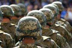 Rows of soldiers in helmets Stock Images