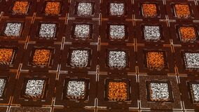 Rows of square shaped QR codes with moving electrical impulses on orange background. Animation. Concept of communication