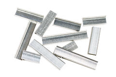 Rows of staples on white background Stock Photo