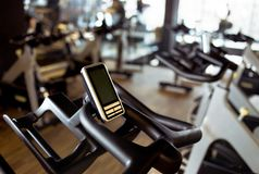Rows of stationary bike in gym modern fitness center room royalty free stock image
