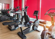 Rows of stationary bikes and treadmills in gym modern fitness center room. Rows of stationary bikes and treadmills equipment health exercise for bodybuilding in Stock Photo