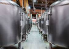 Rows of steel tanks for beer fermentation and maturation. Stock Photo