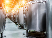 Rows of steel tanks for beer fermentation and maturation. Royalty Free Stock Image