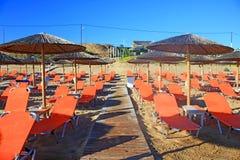 Rows of straw umbrellas Royalty Free Stock Photo