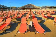 Rows of straw umbrellas Stock Photo