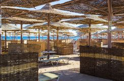 Rows of straw umbrellas from the sun, stretching into the distance on a wide beach on the Red Sea, Makadi Bay, Hurghada royalty free stock image