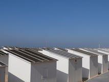 Rows of summer beach huts on a tropical beach Stock Photo