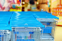 Rows of supermarket shopping cart trolleys Royalty Free Stock Photo