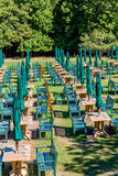 Rows of Tables with Green Benches Royalty Free Stock Photo
