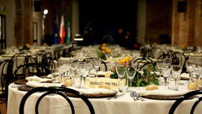 Rows of tables set for a public party. Stock Photo