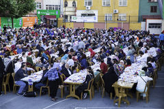 Rows of tables set up for Ramadan. And people waiting the Iftar food near the Eyup Sultan Mosque at Ramadan, Eyup, Istanbul, Turkey Royalty Free Stock Photography