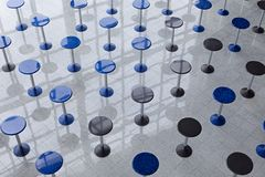 Rows of tall round tables Royalty Free Stock Photo