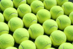 Rows of tennis balls. A close up on rows of tennis balls. Could be used for a wallpaper or background Stock Photography