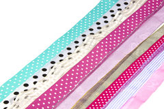 Rows of Textured Spotted Ribbons on White Royalty Free Stock Photography